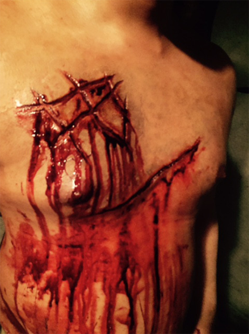 """Ritual marks on a man's body from """"GEHENNA~Where Death Lives~"""""""
